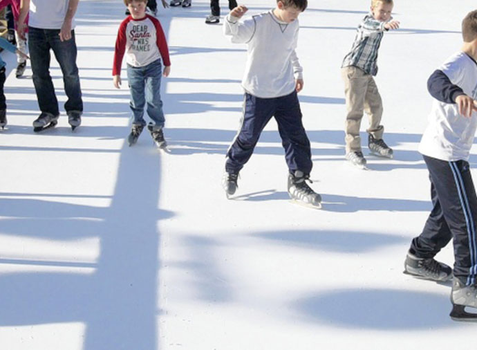 Image of kids skating on synthetic ice