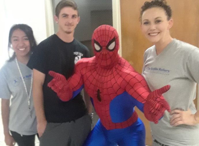 Image of Spider Man and Roll n Fun Zone Staff Members